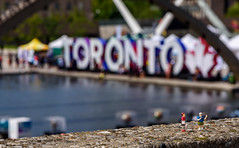 Toronto Tourists (John G Briggs) Tags: preiser ho scale littel figures toronto outdoors outside micro bokeh nathan phillips square iconic sign pan am games
