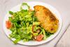 Chicken Kiev with salad (garydlum) Tags: chicken belconnen chickenkiev lemonjuice tomato lettuce springonion lemonzest canberra oliveoil sunflowerseeds