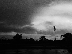 Drive By (Harley Mitchell) Tags: drive street streetphotography blackandwhite gloomy storm thunderstorm rain