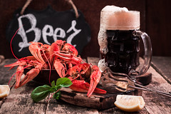 boiled crawfish and beer on a wooden background (cristina perciuleac) Tags: background beer boil claw cooked crab crawfish crayfish delicious dinner eat fish food fresh gourmet healthy lobster lunch meal nutrition plate prepared red rustic seafood shell shellfish snack tasty wooden mug woodenmug vintage boiled table bar celebrate light bavaria alcohol foam rural party drink hops event gastronomy amber octoberfest oktoberfest