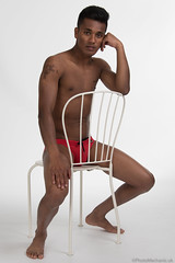 Ashwin (PhotoMechanic.uk) Tags: male man guy dude youth model pose photoshoot studio shirtless topless speedo speedos swimming trunks swimmer swimwear diver red body physique muscle muscular masculine chest nipple foot feet barefoot sit sitting chair