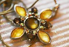 All that bling-bling! (Through Serena's Lens) Tags: smileonsaturday blingbling accessories pendant necklace imitationgems shiny bokeh stilllife dof macro canoneos6dmarkii jewelry