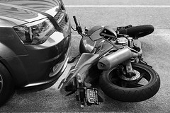 some guy's gonna be pissed (mitchell haindfield) Tags: motorcycle parking parallel putitdown down tipped kickstand bike honda urban city street accident tapping damage collision driving hit owner rider trashed roadrage public sidewalk