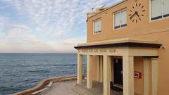 Coogee Beach, Sydney  #3404 (lynnb's snaps) Tags: 201709 coogeebeach sydney beach city slsc coast ocean horizon pastels clock surflifesavingclub architecture australia eastcoast sky clouds ©lynnburdekin2017