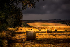 Sunset Stockpile (Augmented Reality Images (Getty Contributor)) Tags: sunshine countryside summer perthshire landscape sunset scotland fields bales leefilters canon strawbales harvest clouds dunning unitedkingdom gb