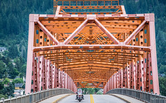 2017 - Road Trip - Nelson - Big Orange Bridge - 1 of 3 (Ted's photos - For Me & You) Tags: 2017 bc canada cropped nikon nikond750 nikonfx tedmcgrath tedsphotos vignetting nelson nelsonbc bigorangebridge bob nelsonbigorangebridge bigorangebridgenelson motorcycle railing railings streetscene street yellowline curb sidewalk road roadway highway bridge bridgedeck nelsonbridge bridgenelson cans2s