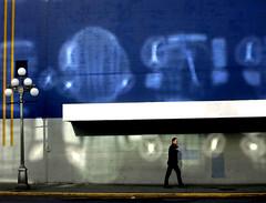 walking man (SheffieldStar) Tags: bc britishcolumbia canada pacificnorthwest victoria odeoncinema man walking allinblack reflectedlight graffiti streetphotography downtown wall