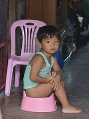 taking care of business (the foreign photographer - ฝรั่งถ่) Tags: boy seated plastic toilet defecating khlong thanon portraits bangkhen bangkok thailand nikon d3200