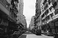 Quiet Street (superzookeeper) Tags: eos1 analog film ilford hk hongkong ilforddelta100 delta100 canoneos1 ef2470mmf28liiusm monochrome blackandwhite ssp shamshuipo eos bnw oldhk oldhongkong princeedward mk mongkok oldbuilding car favorites over1000views street
