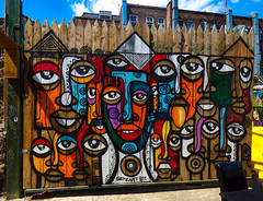 Fence Faces (Steve Taylor (Photography)) Tags: faces senzart senzart911 art graffiti mural streetart building fence chair table colourful vivid uk gb england greatbritain unitedkingdom london wooden tonguue