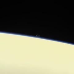 Enceladus Setting Behind Saturn (NASA's Marshall Space Flight Center) Tags: nasa nasas marshall space flight center cassini jpl jet propulsion laboratory solar system beyond saturn enceladus