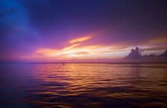 Cozumel Sunset (byron bauer) Tags: byronbauer caribbean cozumel yucatan mexico ocean water sea sky clouds sunset boat blue orange purple sailboat color