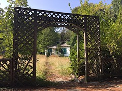 Unglamorous Entrance (flickr flame) Tags: abandoned decay deterioration unglamorous entrance trellis wood gateway walkway building