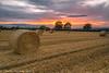 Bales At Sunset (Steven Peachey) Tags: landscape sunset sky sun clouds dusk evening field farmland ef1740mmf4l lee09gnd 5dmarkiv canon5dmarkiv haybales harvest canon keepaway