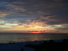 Siesta Key Sunset (Jim Mullhaupt) Tags: sunset sundown dusk sun evening endofday sky clouds color red gold orange pink yellow blue tree palm outdoor silhouette weather tropical exotic wallpaper landscape siestakey sarasota florida 1beach america usa vacation holiday travel warm gulfofmexico sarasotacounty family fun gulfcoast palmtrees sunsets sunrises awesome swimming beach bikini whitesand iphone6