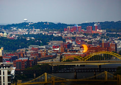 Eclipse over Liberty Bridge (Deliberate Spoonerism) Tags: eclipse sun moon astrophotography 70200 canon 5d mark iii mk3 mkiii f4 usm is color contrast bridge architecture blue red yellow trees tower water outdoors river pennsylvania pa pittsburgh united states us usa northeast