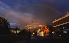 somewhere under the rainbow (redux) (amazingstoker) Tags: basingstoke amazingstoke basingrad rainbow london road drama sky cloud rain low evening lumiere pedestrian crossing traffic lights little green man shadow light new lamppost timber frame sunset