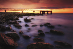 Between storms II (Explore #1) (Anto Camacho) Tags: sunrise pier xilxes rocks seascape longexposure storm landscape beach spain castellón colours sunshine raylights