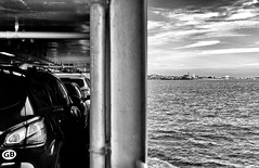 The Passengers (Missy Jussy) Tags: royan france southwestfrance soulacsurmer trip travel transport tourism tourists holiday ferry boat boattrips sky clouds land horizon sea ocean atlanticocean canon canon5dmarkll 50mm ef50mmf18ll canon50mm fantastic50mm mono monochrome blackwhite bw blackandwhite buildings town seaside