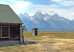 Mirage mountain and woman at Mormon barns in Wyoming (robmcrorie) Tags: mormon row barns farm teton grand national park wyoming mountain plain house shed wood trunk iphone 7 plus human figure