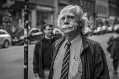 A Bushy Moustache (Leanne Boulton) Tags: people portrait urban street candid portraiture streetphotography candidstreetphotography candidportrait streetportrait streetlife eyecontact candideyecontact man male face facial expression eyes look emotion feeling mood moustache tone texture detail depthoffield bokeh naturallight outdoor light shade shadow city scene human life living humanity society culture canon canon5d 5dmkiii ef2470mmf28liiusm black white blackwhite bw mono blackandwhite monochrome character glasgow scotland uk