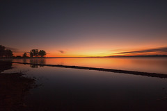 Orange Slice (mclcbooks) Tags: lake landscape sunrise dawn daybreak clouds reflections trees silhouettes shore lakechatfield chatfieldstatepark colorado le longexposure