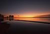 Orange Slice (mclcbooks) Tags: lake landscape sunrise dawn daybreak clouds reflections trees silhouettes shore lakechatfield chatfieldstatepark colorado le longexposure