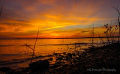 Sunset at Clarks Hill Lake (K.Yemenjian Photography) Tags: dslr sunset clarkshilllake waves water lake shore clouds landscape rock rocks cloudy skyline beautyofnature georgia georgiausa orangesky canon canont5i wideangle silhouette t5i 700d canon700d placescity