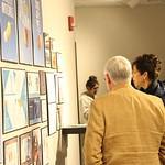 Community members looking at the capstone fine art projects.