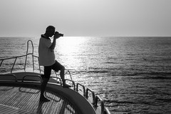 (saavedl) Tags: lx5 redsea boat people backlight sea sunrise sun