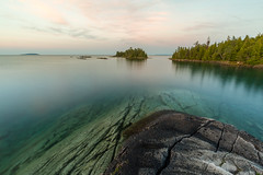 the Bruce (Marc McDermott) Tags: water trees nature rocks lake georgianbay brucepeninsula northern ontario canada sky clouds sunset tranquil polarizing filter polarizer summer brucepeninsulanationalpark shore calm