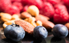 Blueberries (Maria Eklind) Tags: macrodesserts dof eathealthy stayinghealthy reflection spegling sweden healthymeal depthoffield colorful macro malmö nuts blueberry hallon blåbär closeup bokeh meal fruit raspberry food