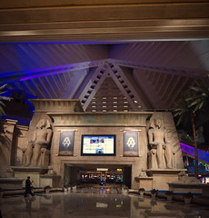 luxor entrance vpan (n.a.) Tags: luxor egyptian ancient theme casino resort hotel las vegas nevada nv usa night pyramid blue yellow sphinx pharoah guards palm trees