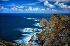 Cabo de Peñas. (hajavitolak) Tags: paisaje seascape landscape largaexposición longexposure sea cabo cabodepeñas asturias naturaleza nature nubes clouds azul blue beautiful sinespejo evil mirrorles zeiss za zeiss3528 sony sonya7ii sonya7m2