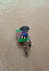 Voyage by wheels (Aranya Ehsan) Tags: people life rain flood bangladesh dhaka lifestyle aranya