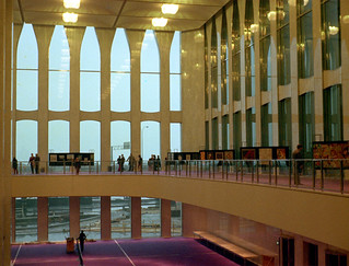 The brand new World Trade Center lobby during the Port Authority employee opening day celebration. The abandoned West Side Highway is visible through the large lobby windows. It was a gray, rainy day. Late March 1973. New York.