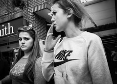 Colchester 2017 (XBeauPhoto) Tags: bw colchester essex candid cigarette citylife girls monochromatic monochrome nike smoking streetphotography urban