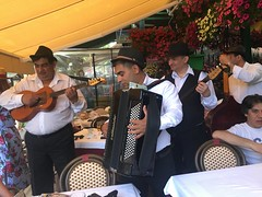Rom people playing music while people eat at restaurant at the bohemian quarter of Skadarlija street!
