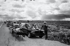 Roadside Vendors Awaiting the Storm (keycmndr) Tags: blackandwhite clouds film landscape newmexico people streetphotography taos