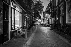 Home Again (McQuaide Photography) Tags: haarlem noordholland northholland netherlands nederland holland dutch europe sony a7rii ilce7rm2 alpha mirrorless 1635mm sonyzeiss zeiss variotessar fullframe mcquaidephotography lightroom adobe photoshop tripod manfrotto stad city urban lowlight dusk twilight architecture outdoor outside illuminated street straat kokstraat wideangle wideanglelens groothoek building longexposure oldstreet old oud character traditional authentic streetlight emptystreet deserted empty nopeople cobblestone cobbles shadow light licht shop blackandwhite mono monochrome bw blackwhite house home door window residential pedestrian nocars residence woning huis