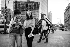 Don't Worry Be Happy (mkc609) Tags: street streetphotography bw blackandwhite blackwhite urban candid nyc newyork newyorkcity happy behappy asian downtown stmarksplace cube cellphone girls