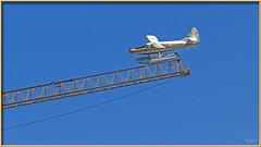 Narrow Runway (Sugardxn) Tags: garypentin sugardxn northwest photoshop picswithframes frame seattle canon canon7d canoneos7d pontoon seaplane sky crane plane unionlake