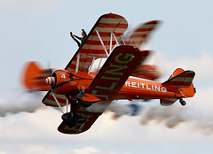 Wing Walkers (Bernie Condon) Tags: breitling wingwalkers girls ladies aerobatics wingwalking aerosuperbatics boeing stearman trainer vintage classic preserved aircraft plane biplane uk british shuttleworth collection oldwarden airfield airshow display aviation flying