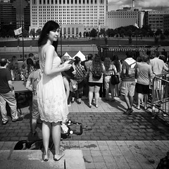 Above the Crowd (tim.perdue) Tags: above crowd festival latino columbus ohio genoa park scioto mile riverfront downtown urban city black white bw monochrome people girl woman person figure dress sundress