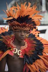 Seul au milieu du bruit -*--- ° (Titole) Tags: nottinghillcarnival man costume titole nicolefaton orange feathers black thechallengefactory