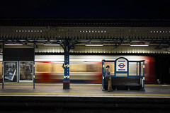 Turnham Green, Eastbound District Line Train Arrives (London Less Travelled) Tags: england britain unitedkingdom london tube underground station platform night dark motion district line turnhamgreen