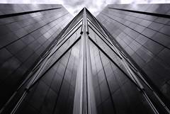 Abstract architecture (*Chris van Dolleweerd*) Tags: architecture abstract bw chrisvandolleweerd urban glass facade reflections modern clouds sky fujifilmx100s street w