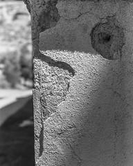 2675023 (agianelo) Tags: bw building stucco shadow texture crack corner