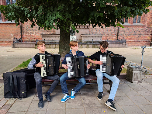 Music students playing accordion for some extra cash, Kaunas