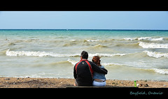 Together (Poocher7) Tags: people portrait candid together embrace hug closeness couple blackandredjacket jeanjacket darkhair redhair wind waves sand picnictable wavewatching romantic sunglasses lakehuron greatlakes bayfield ontario canada latesummer snuggling tenderness sweet